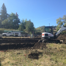 Large stepped house pad, utilities, backfilling in Ashland